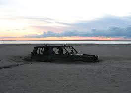 Abandoned Car On Beach